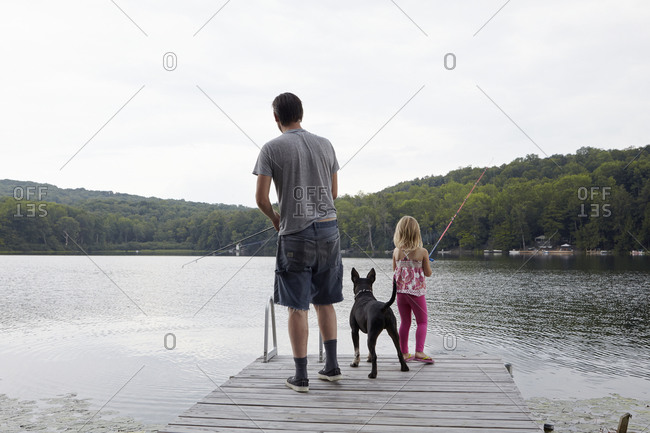 Family fishing from a jetty