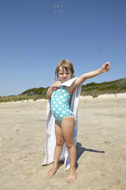 Little girl posing on beach