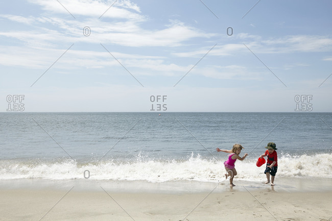 Children enjoy the waves on the beach