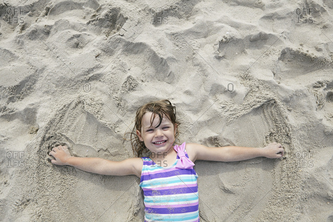 Little girl enjoying the deep sand