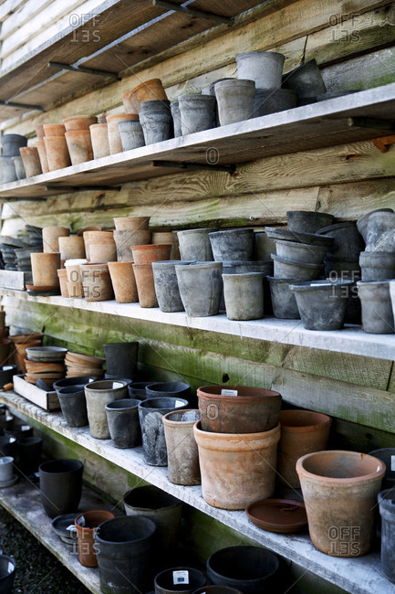 Pots line multiple shelves