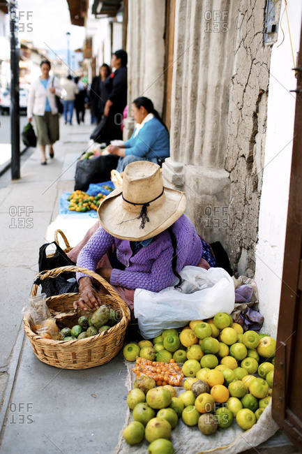 A woman sells fruit on the street