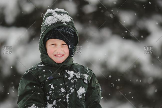 Boy in snowsuit outside smiling