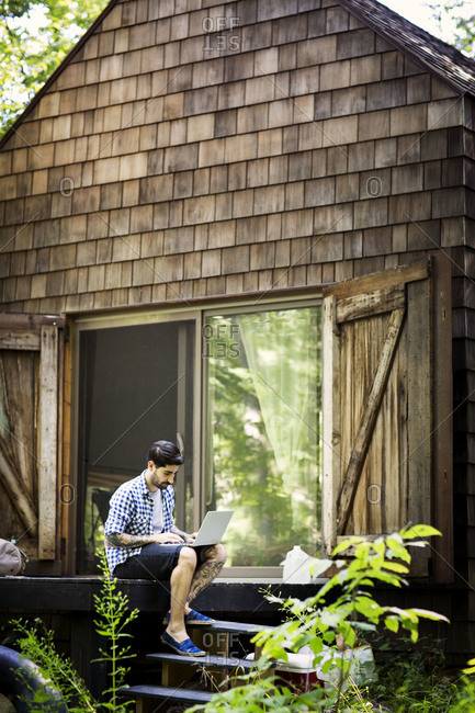 Man sitting on porch in woods