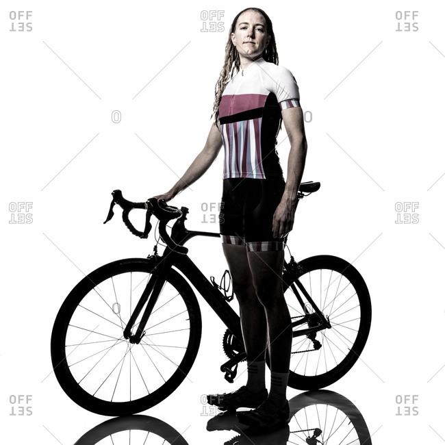 Female cyclist with her bike
