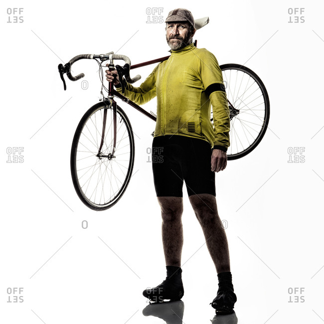 Man holding his bicycle on his shoulders
