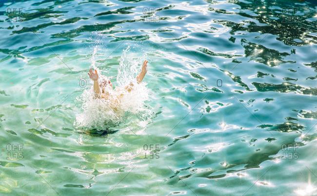 Child splashing in the water