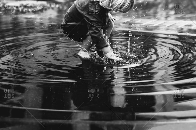 Boy playing in puddle - Offset