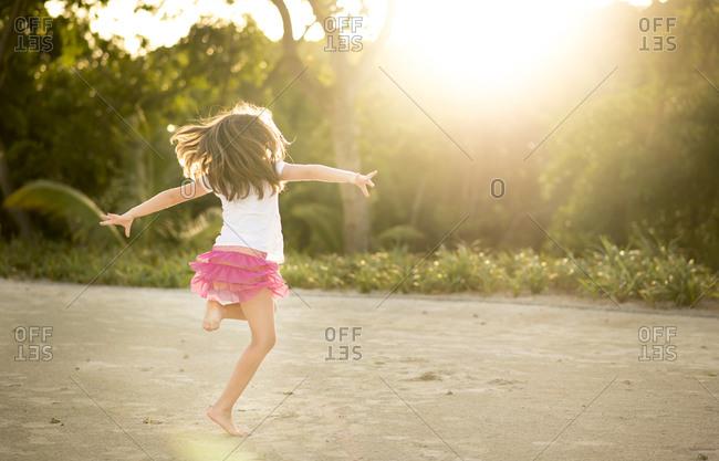 Girl in pink tutu dancing outdoor