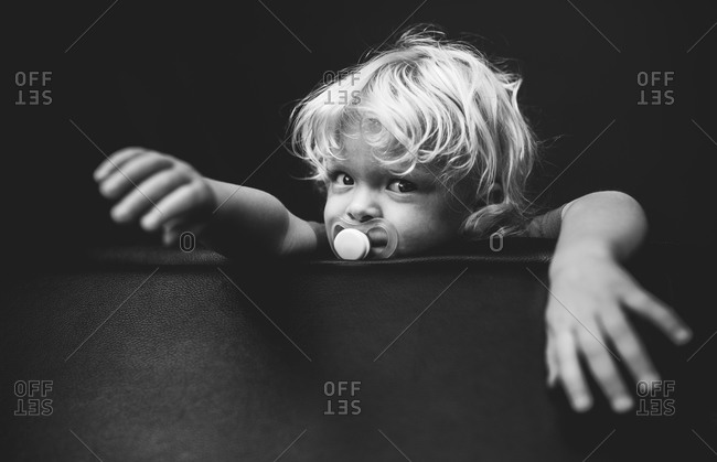 Portrait of boy with a pacifier