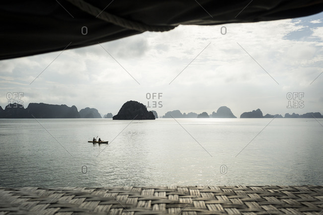 Kayakers in Bai Tu Long Bay, Vietnam on an overcast day