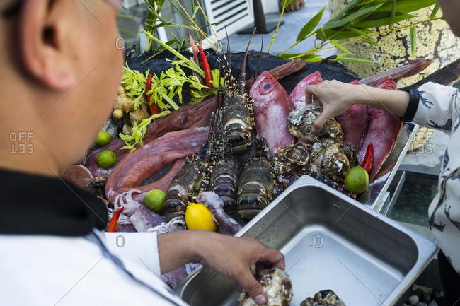 Selecting fresh seafood at a local restaurant in Danang, Vietnam