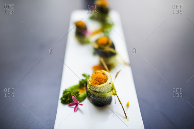 A seafood restaurant in Danang, Vietnam displays grilled fish with roe and herbs