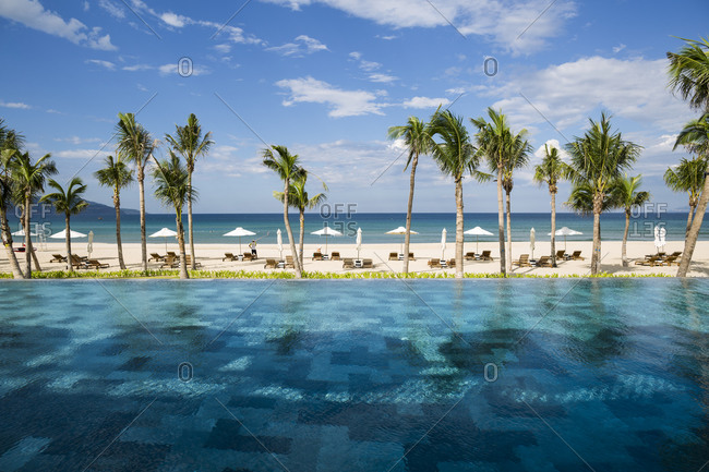 Danang, Vietnam - July 7, 2014: A pool sits next to the beach at a luxury resort