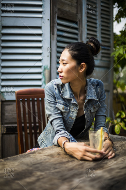 A Vietnamese woman with a drink at a cafe