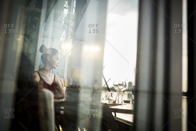 Woman at a restaurant on the banks of the Saigon River