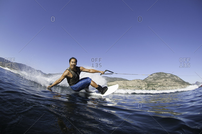 Man wakeboarding on a lake in Penticton, Canada