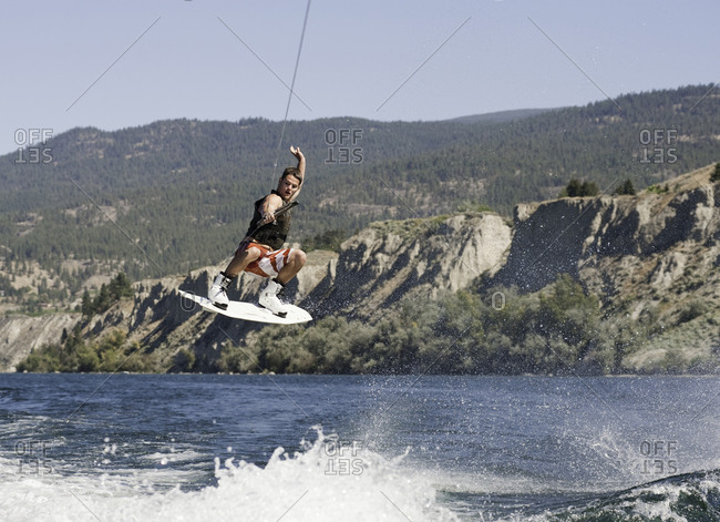 Man performing a wakeboarding stunt on a lake in Penticton, Canada