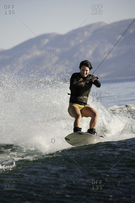 Woman wakeboarding on a lake in Penticton, Canada