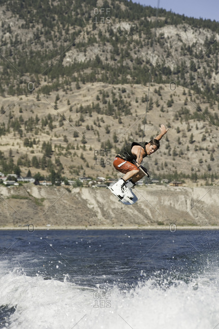 Man jumping high in the air on a wakeboard in Penticton, Canada