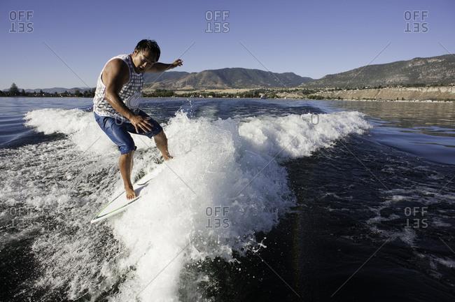 Man wakesurfing behind a boat