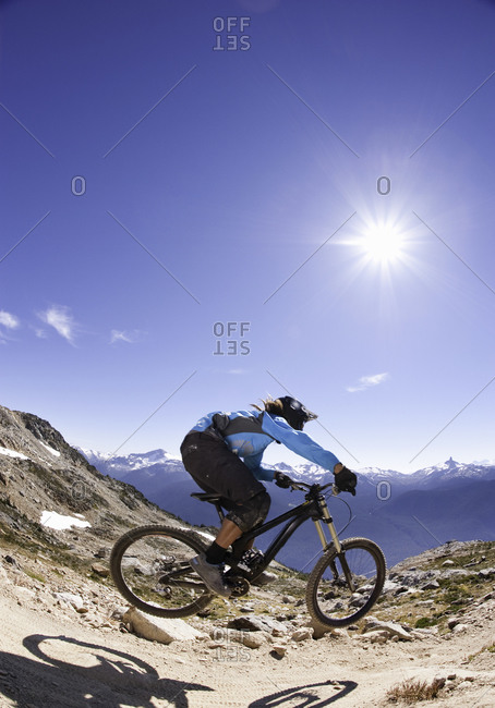Biker jumping with a bicycle on a mountain