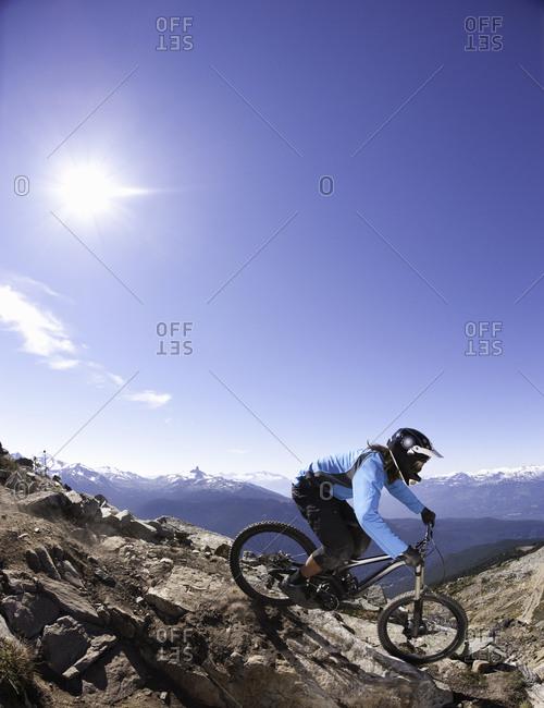 Biker downhilling on a mountain
