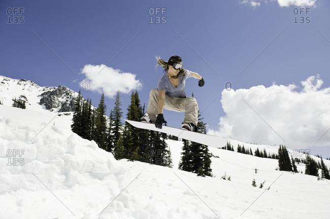 Woman snowboarding on a mountainside