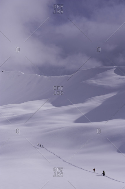 People cross-country skiing in the distance