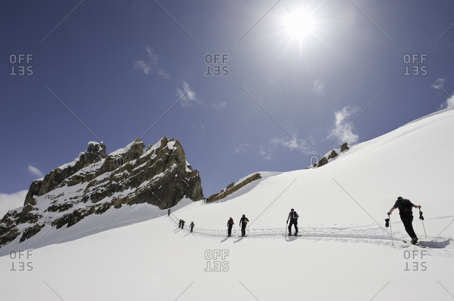 Low angle view of people cross-country skiing