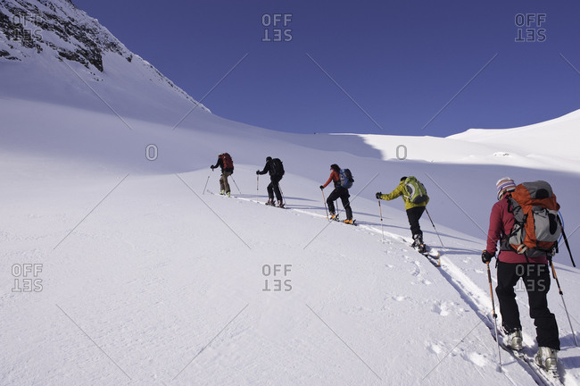 Cross country skiers on mountainous trail