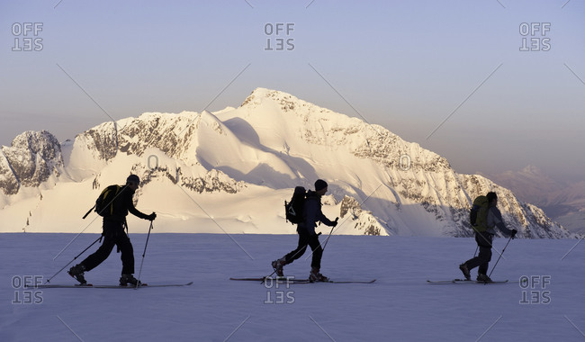 Three people on cross country skis