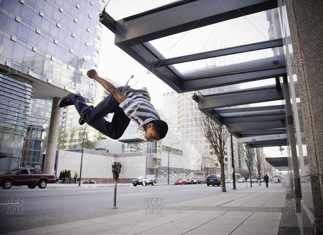 Young man doing backflip
