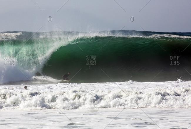 Surfer riding an ocean wave