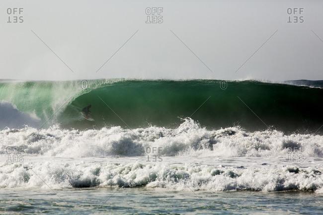 Man riding an ocean wave