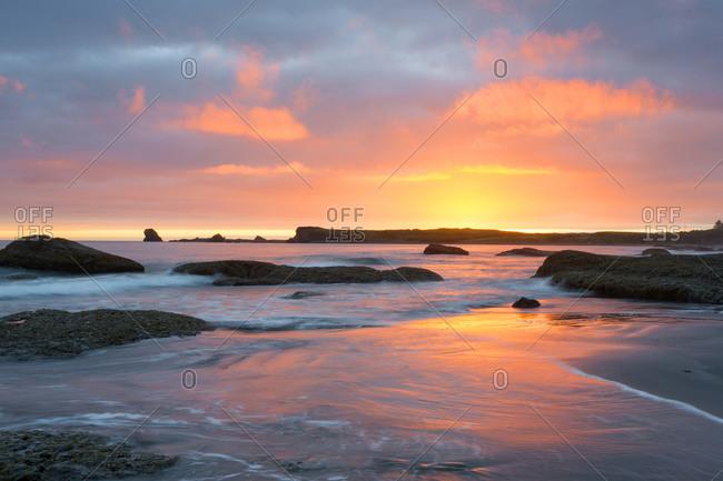 Seastacks in the ocean at sunset