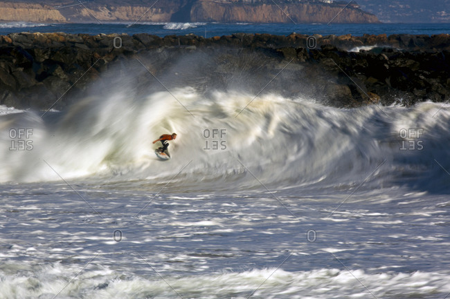 Surfer riding a powerful wave