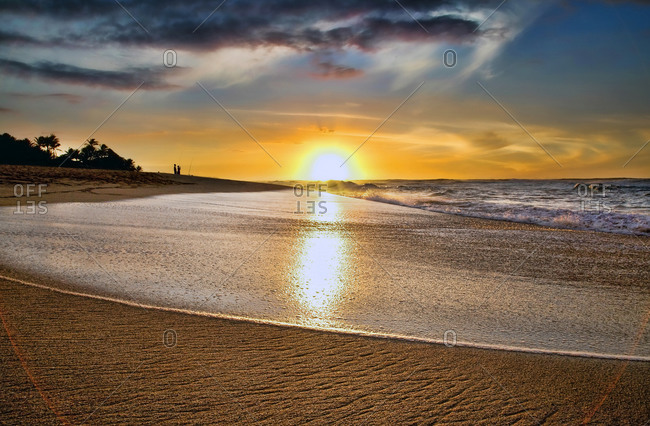 View of a sandy beach at sunset