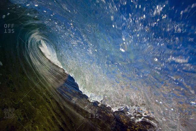 View of a turbulent ocean wave barrel