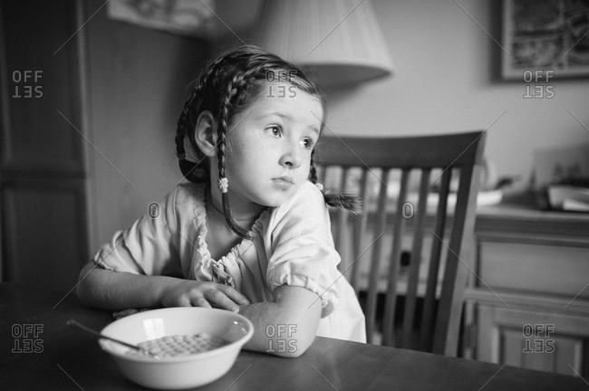 Young girl eating breakfast