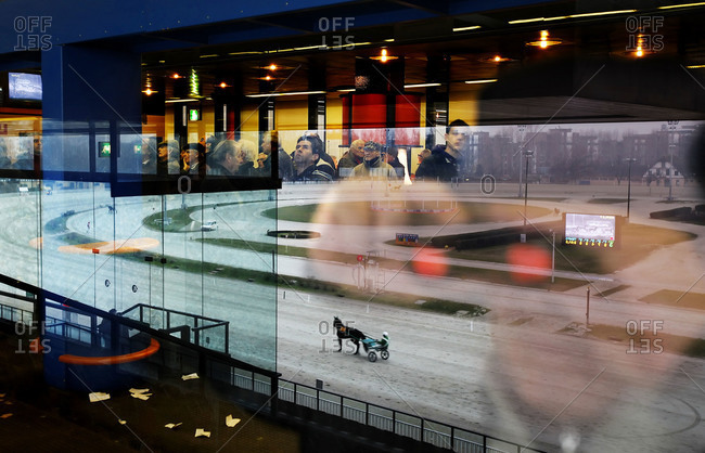 Milan, Italy - January 14, 2010: Men watching a horse race at a track
