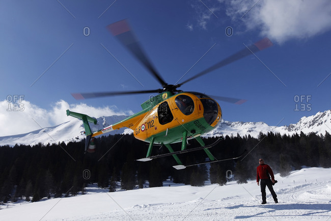 Madonna di Campigli, Italy - March 13, 2010: A military helicopter lands at a refuge