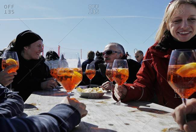 Madonna di Campigli, Italy - March 14, 2010: Tourists enjoying a spritz at a table outside