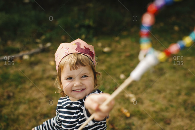 Smiling girl with magic wand