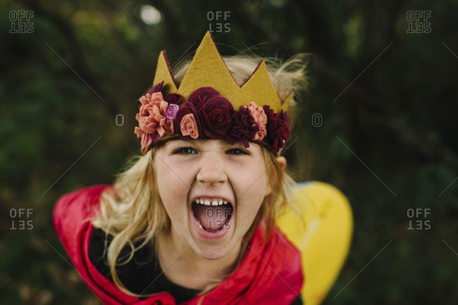 High angle view of blonde girl shouting
