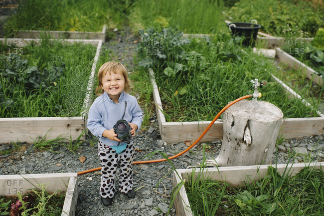 Smiling girl at a community garden