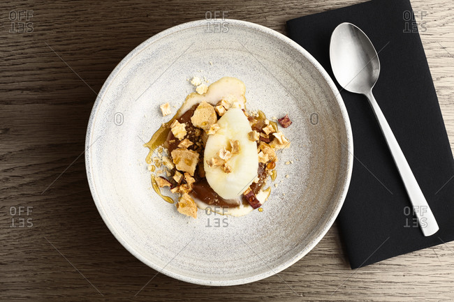Ice cream dessert with apple and chopped nuts