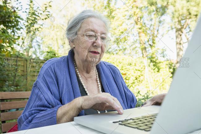 Female senior using laptop