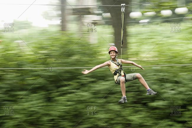 Girl spinning round at crag
