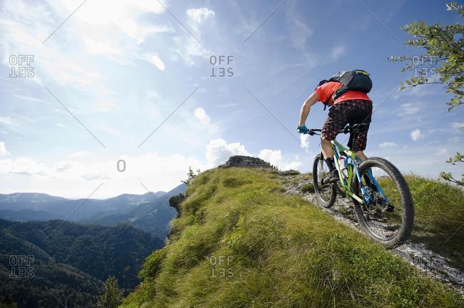 Mountain biker on the way uphill, Slatnik, Istria, Slovenia